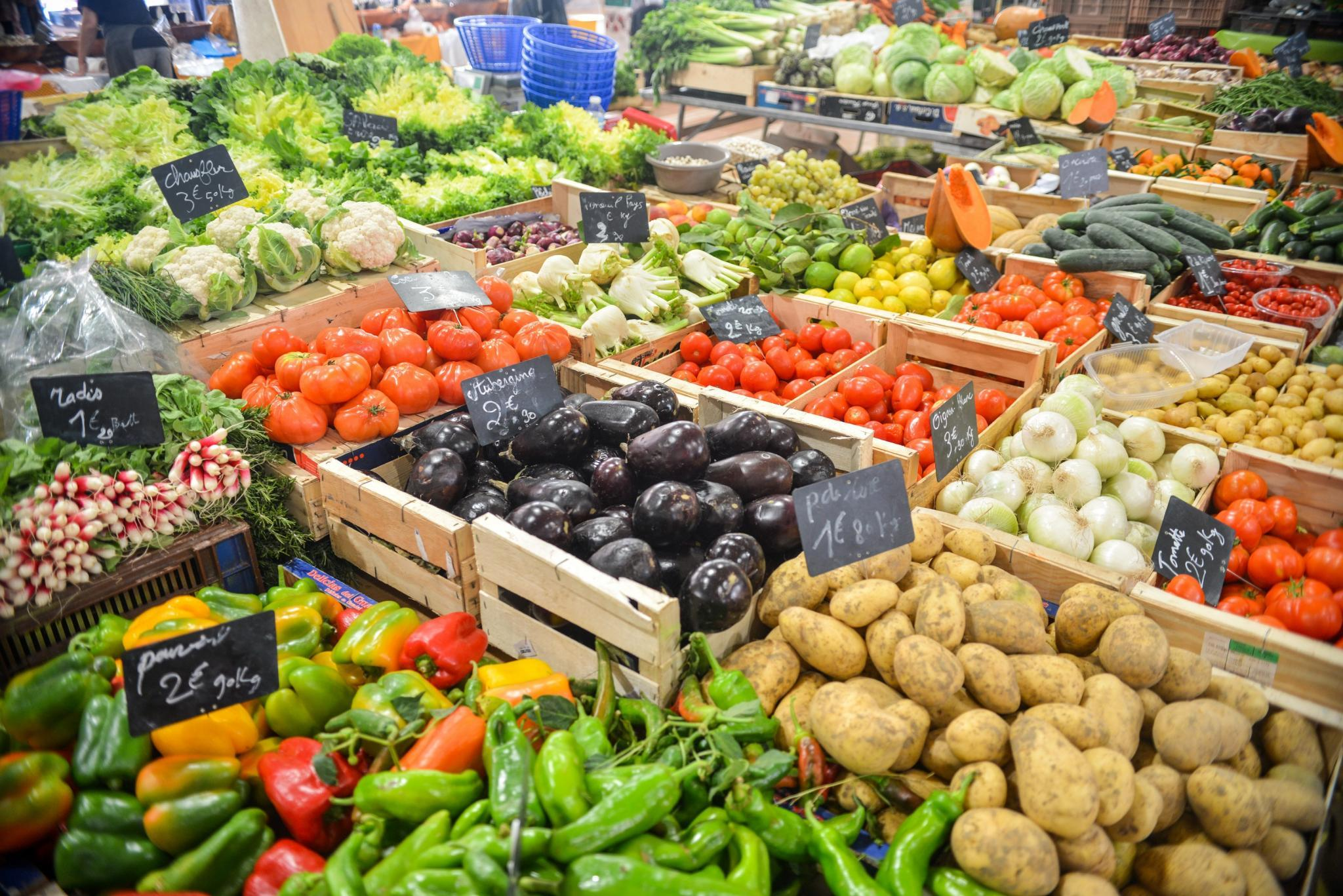 Various vegetables on a market place, organic or GMO?